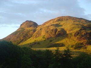 @Edinburgh: not a field...but it will do for scenery Lovely image of Arthur's Seat available by David Monniaux under CC BY-SA 3.0